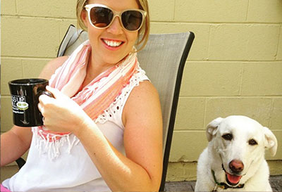 Worman drinking coffee with dog